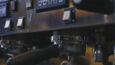 Coffee shop worker using a coffee machine