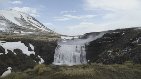 Cold waterfall tumbling over rocks