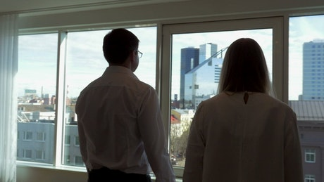 Colleagues looking out of a window