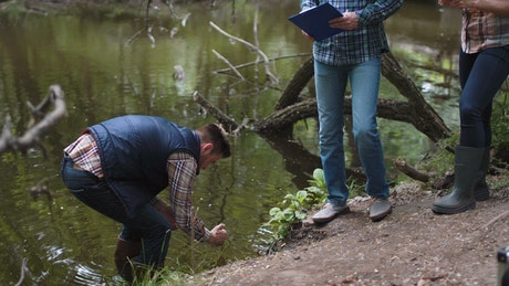 Collecting samples from polluted lake