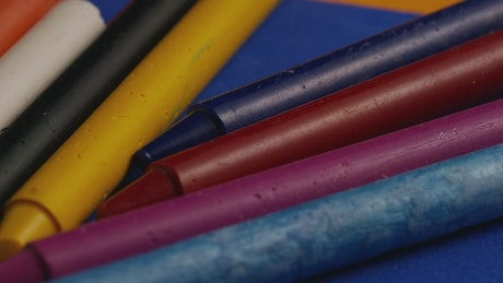 Colored crayons rotating in a close-up shot