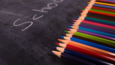 Colored pencils and notebooks
