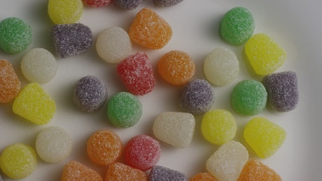 Colored sugary gums spinning slowly