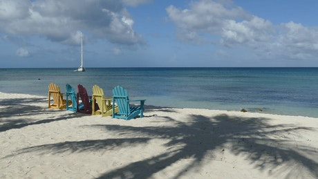 Colorful chairs in front of the ocean