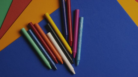 Colorful composition of paper and crayons