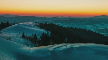 Colorful dawn at a winter mountains
