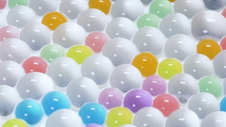 Colorful spheres floating in liquid