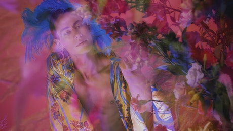 Concept video of an LGBTQ man surrounded by flowers