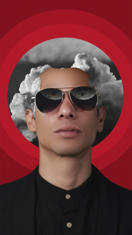 Conceptual image of a man with glasses and hair with sky clouds