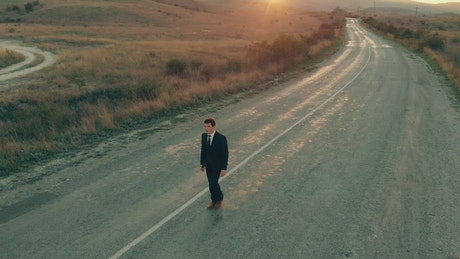 Conceptual video of businessman walking on the road