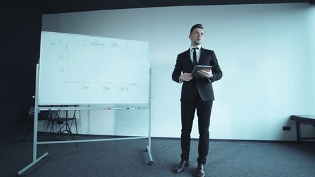 Confident young businessman doing a presentation