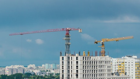 Construction cranes in an apartment building