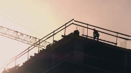 Construction site silhouette in the sunset