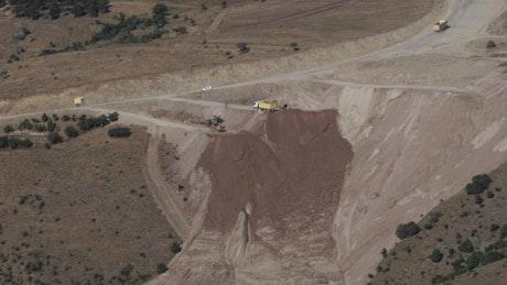 Construction trucks dumping material
