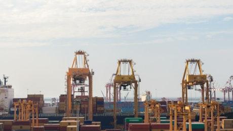 Container cranes unloading a cargo ship