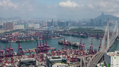 Container port and Hong Kong cityscape