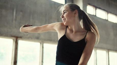 Contemporary dancer in a warehouse