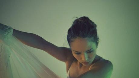 Contemporary dancer posing with a white dress