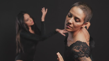 Contemporary dancers dancing separately