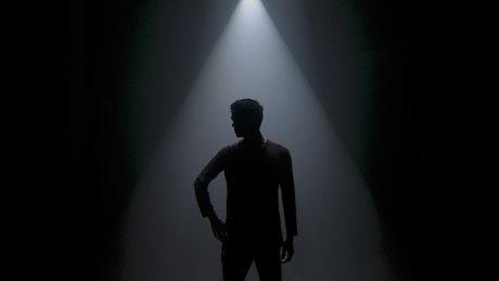 Contemporary male dancer under a spotlight