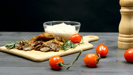 Cooked pork with tomatoes