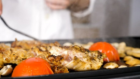 Cooking chicken on a flat grill