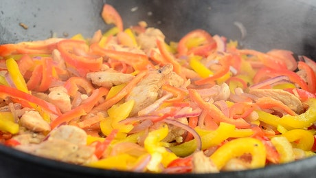 Cooking chicken with chilies