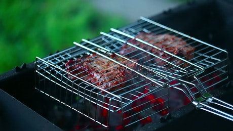 Cooking meat in the grill, close up
