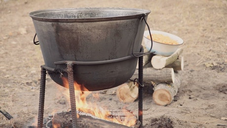 Cooking outdoors with a cauldron in the campfire