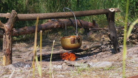 Cooking over a campfire in the country