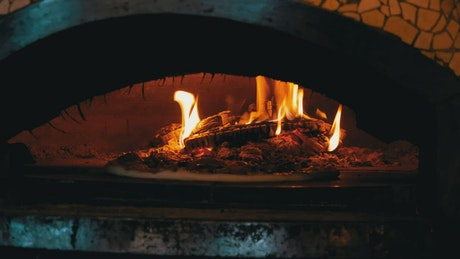 Cooking pizza in a traditional oven