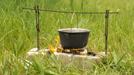 Cooking soup in a country cauldron