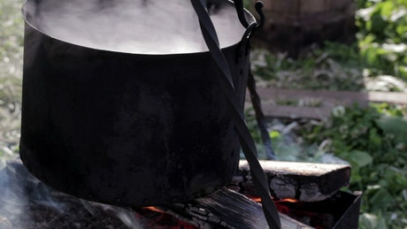 Cooking soup on a campfire