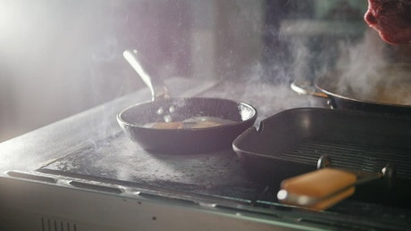 Cooking steak in the kitchen
