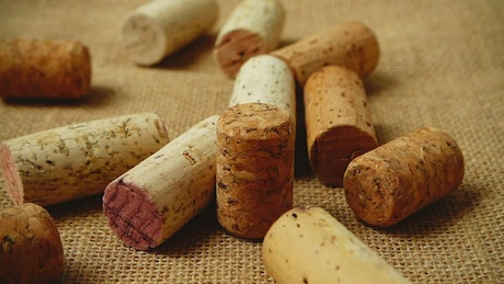 Corks dropping onto a table