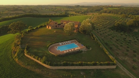 Country house with pool at sunset