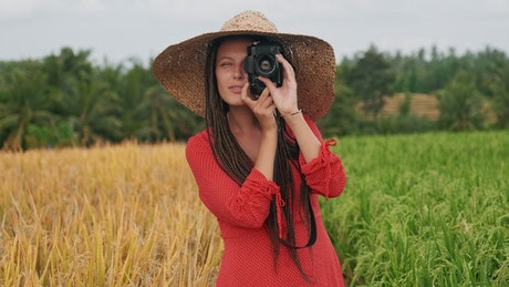 Country woman taking photos in agriculture field