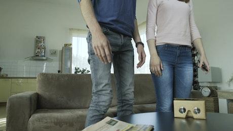 Couple assemble cardboard lenses for virtual reality