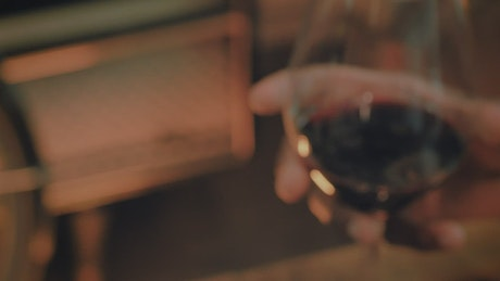 Couple clinking their glasses with wine in a toast