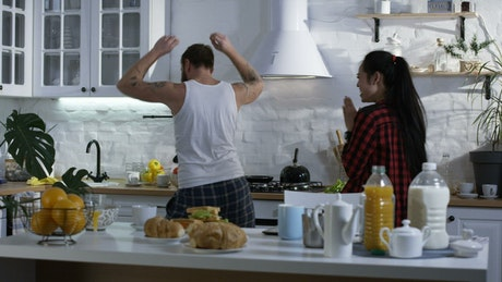 Couple dancing in the kitchen before breakfast