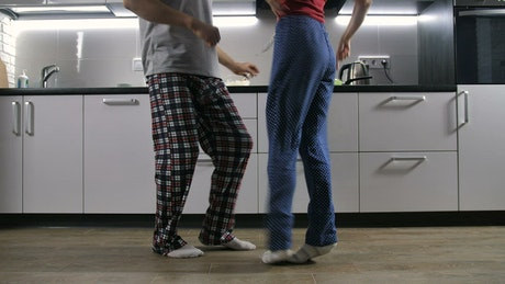 Couple dancing in their apartment