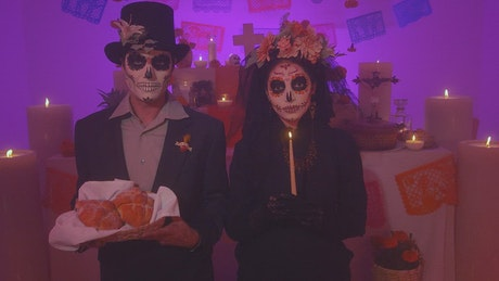 Couple dressed as catrin and catrina on Day of the dead
