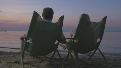 Couple drinking on the beach