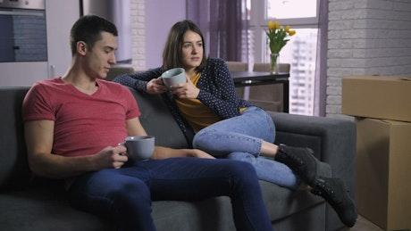Couple drinking tea on the sofa