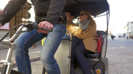 Couple enjoying a Bicycle Taxi ride