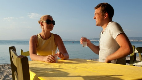 Couple enjoying a drink at the beach