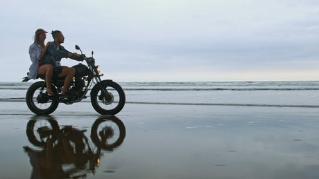 Couple enjoying a motorcycle trip on their beach vacation