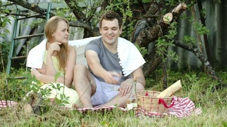 Couple enjoying a picnic in their garden