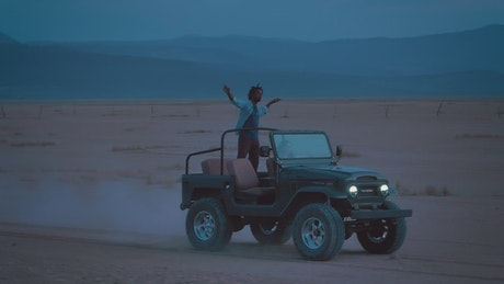 Couple enjoying a trip through a desert
