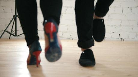 Couple feet dancing salsa in a studio